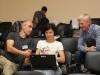 Гунар Сейн, Оксана Дёмина и Ринур Бекмансуров на конференции